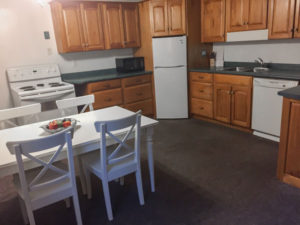 Eat in cottage Kitchen with range, dishwasher, refrigerator; fully equipped.