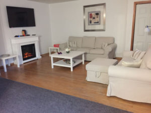 Port Franks Getaway Cottage living room with fireplace, docking station, tv with netflix, android box