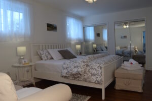 Romantic King bedroom with mirrors, ensuite and sitting area - Upper Suite Serenity luxury vacation apartment for Adults only in Port Franks, Ontario, Canada