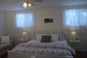 King Bed - Upper Suite Serenity, Port Franks Getaway. Spacious bedroom with lots of light. Adults only vacation apartment