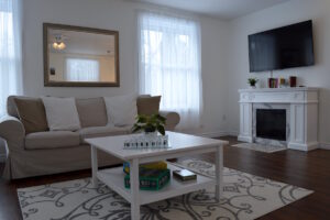 Bright, spacious Living Room with Fireplace - Upper Suite Serenity, Port Franks Getaway, Ontario, Canada Adults only Vacation apartment