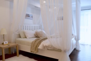 Sweet Dreams - the Romantic Studio Cottage king size canopy bed will make you feel like you are in a fairytale