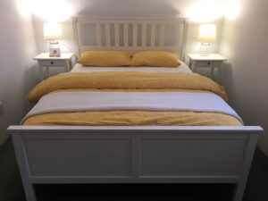 Queen Size Bed in the second bedroom of Diane's Cozy Cottage. Bring your friends and enjoy an adults only getaway