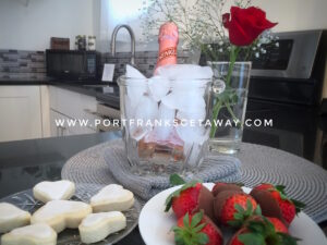 Romance starts Here - Sparkling Rosé, chocolate covered strawberries, heart shaped sugar cookies, a single rose; Valentines is our favourite time of year! Upper Suite Serenity, Port Franks Getaway, Ontario, Canada